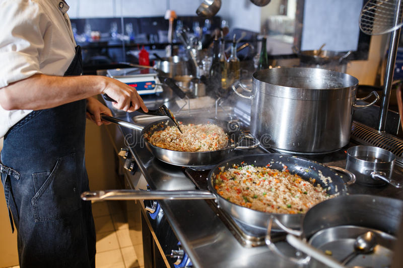 Risotto in a pan being cooked in a restaurant stock photography