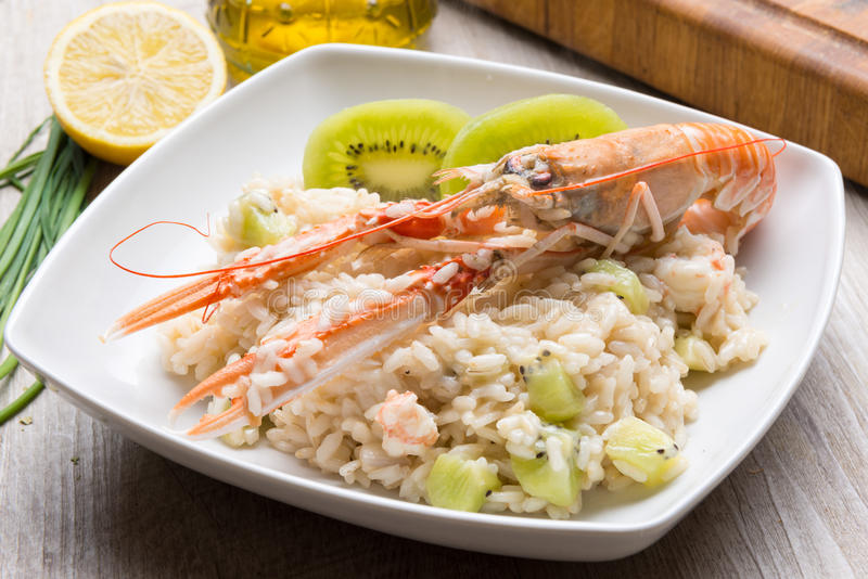 Risotto with prawn and kiwi stock photography