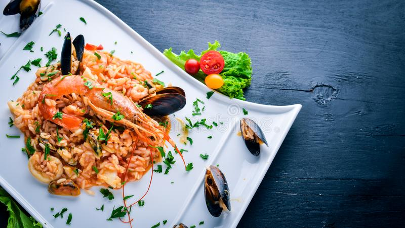 Risotto with seafood and royal shrimp royalty free stock photos