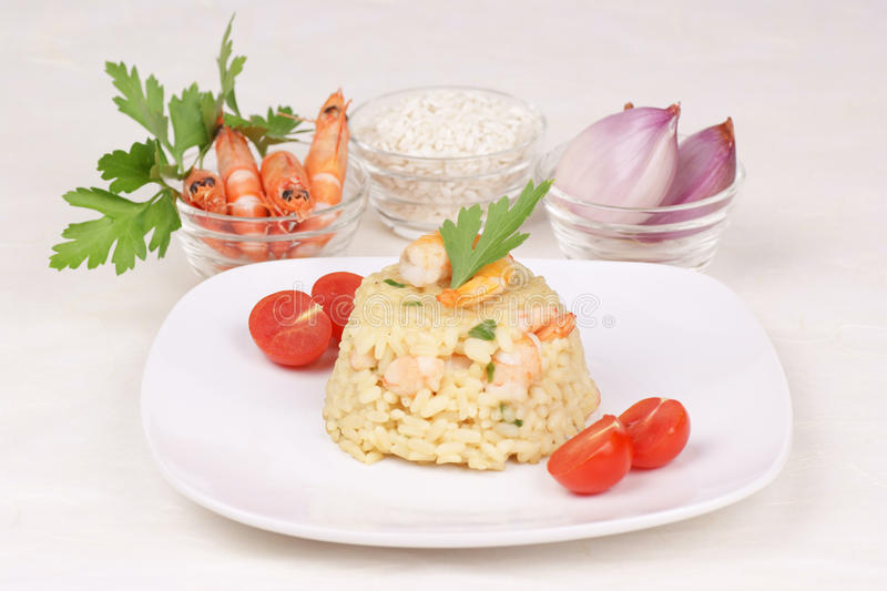 Risotto with shrimps and its ingredients stock images