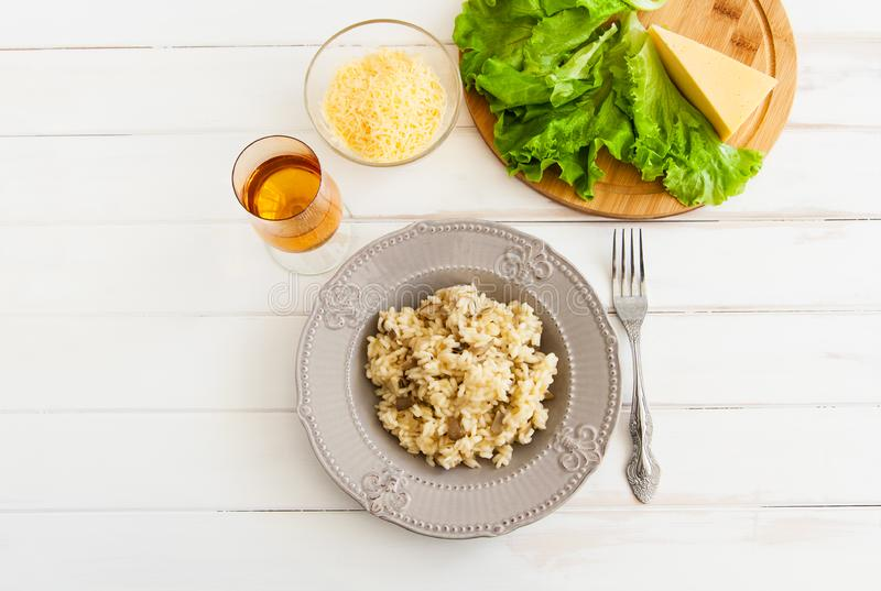 Risotto on a white background. Healthy mushroom risotto on a white background stock image