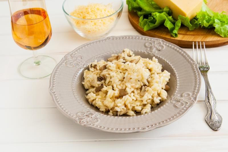 Risotto on a white background. Useful mushroom risotto on a white background stock photography