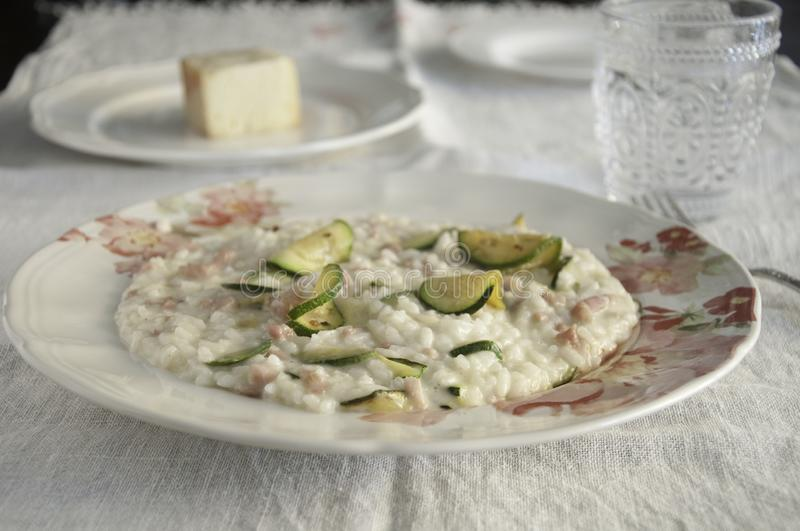 Risotto with zucchini, pancetta and taleggio cheese royalty free stock image