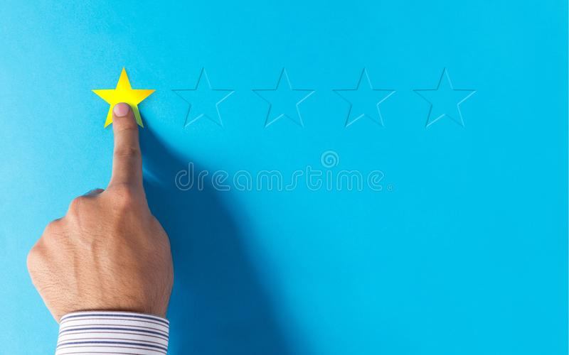 Risposte negative - mano che sceglie valutazione una stella immagini stock libere da diritti