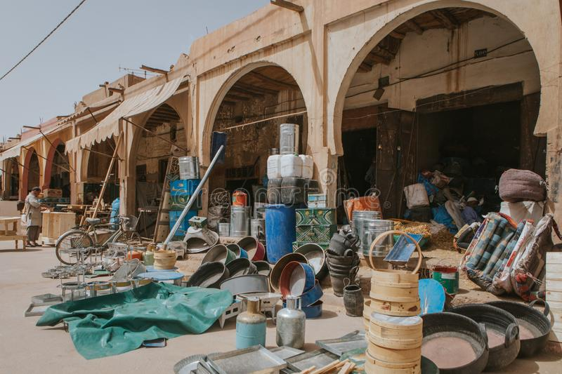 second hand and other stuff shop, in the middle of the street, at Rissani bazaar market in Morocco stock image