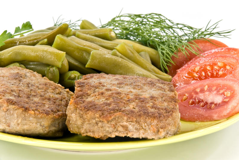 Rissoles e vegetais da carne fotografia de stock