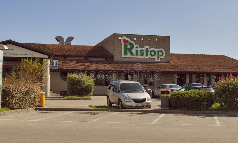 Ristop. Parked cars in front of autogrill Ristop open 24 hours a day for many different travellers who stop along the motorway. Airest is an Italy based food and stock photography