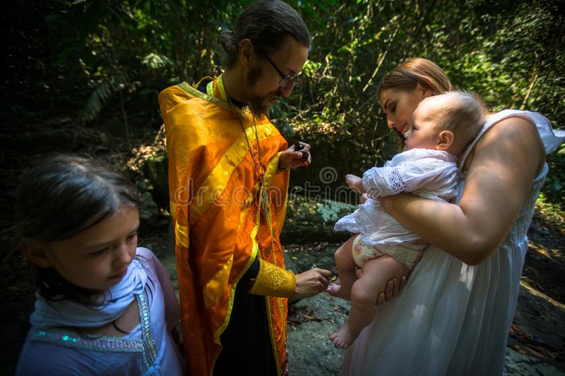 During rites Baptism immersion in water - the first and most important Christian mystery, sacrament of spiritual birth. KOH CHANG, THAILAND - MAR 10, 2018 stock image