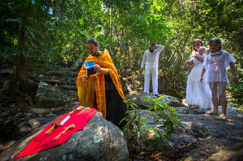 During rites Baptism immersion in water - the first and most important Christian mystery, sacrament of spiritual birth. KOH CHANG, THAILAND - MAR 10, 2018 royalty free stock photo