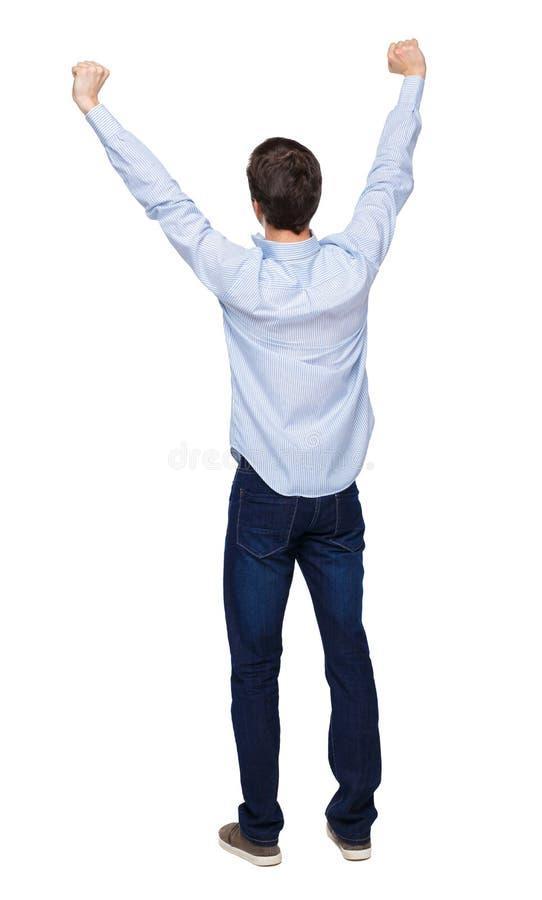 Ritorno di un uomo che celebra la vittoria immagine stock libera da diritti
