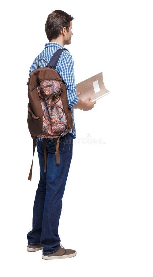 Ritorno di uno studente Il tizio con lo zaino e i libri di testo fotografia stock