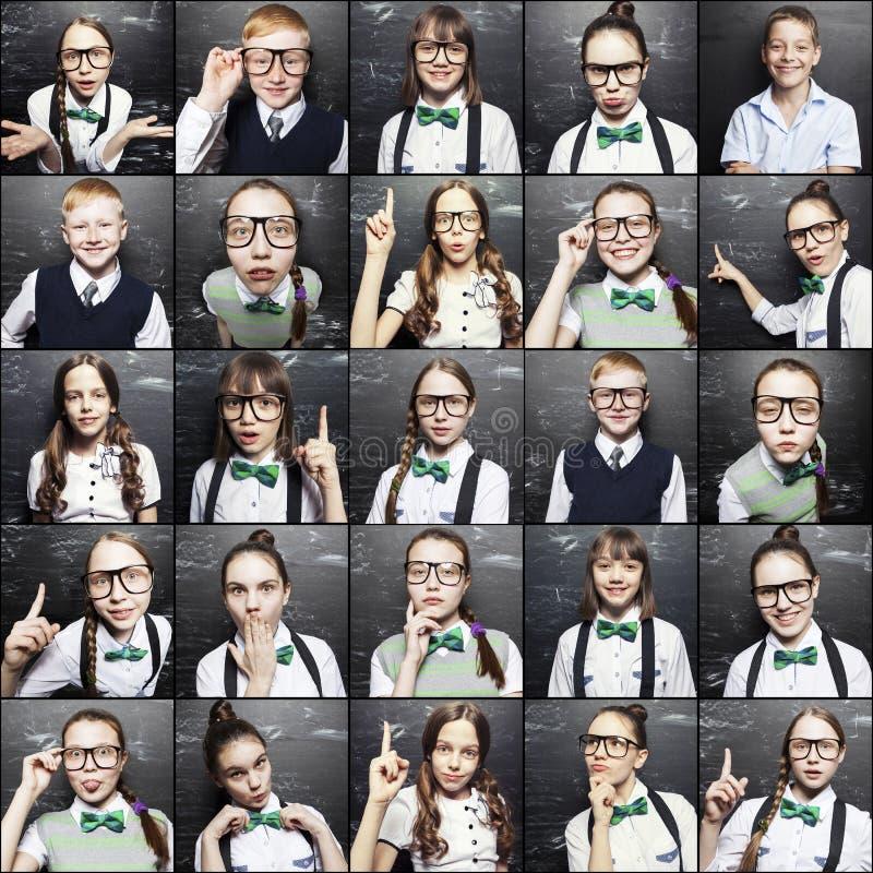 Ritratti dei bambini vicino ad un consiglio scolastico fotografia stock libera da diritti