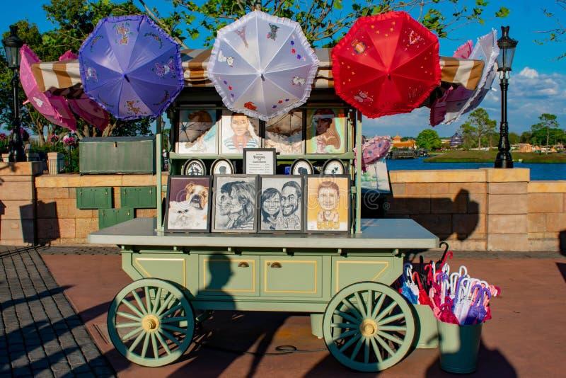 Ritratti progettati con una matita e gli ombrelli variopinti al padiglione della Francia a Epcot in Walt Disney World fotografia stock libera da diritti