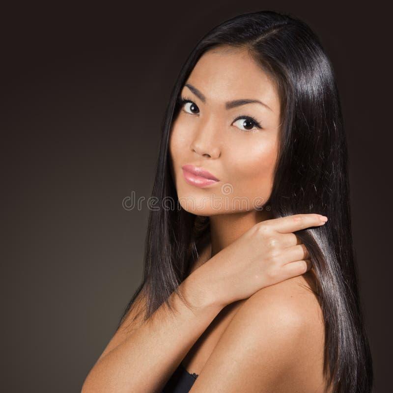 Ritratto asiatico del primo piano del fronte di bellezza della donna fotografia stock libera da diritti