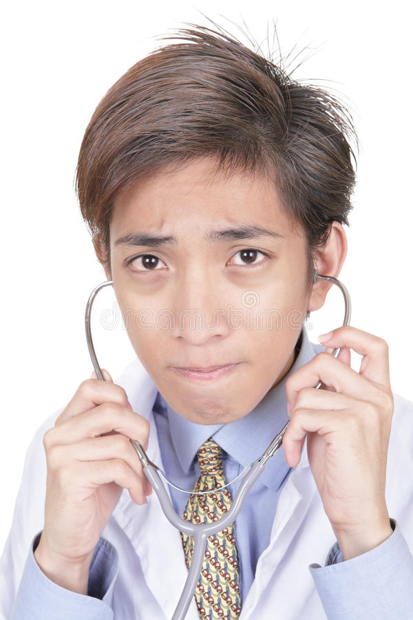 Ritratto asiatico preoccupato del medico fotografie stock libere da diritti