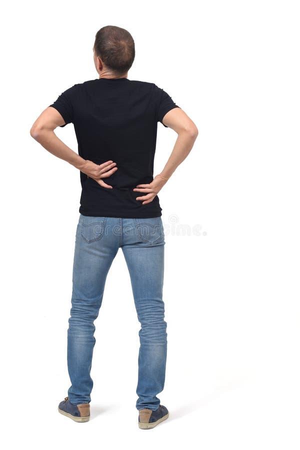 Ritratto completo dell'uomo su dolore alla schiena immagine stock