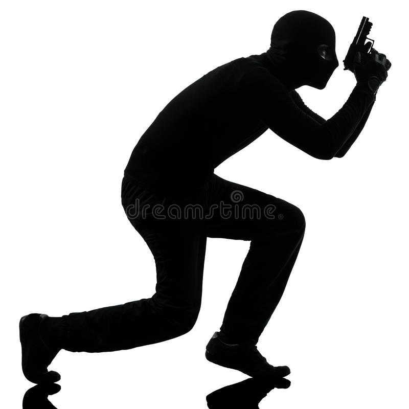 Ritratto criminale della pistola della holding del terrorista del ladro immagini stock libere da diritti
