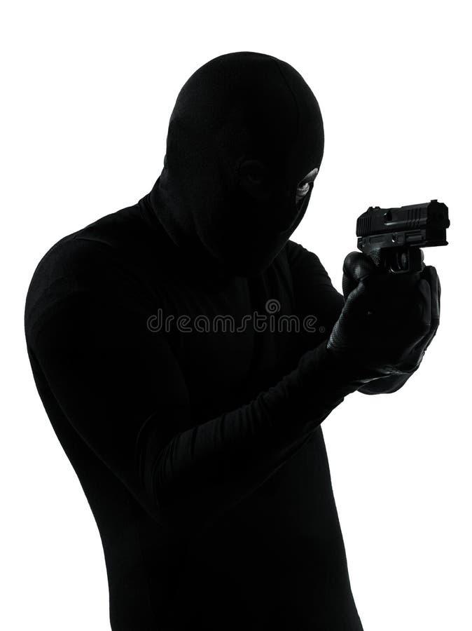 Ritratto criminale della pistola della holding del terrorista del ladro fotografia stock libera da diritti