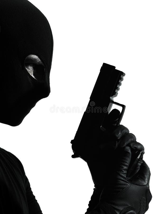 Ritratto criminale della pistola della holding del terrorista del ladro immagine stock