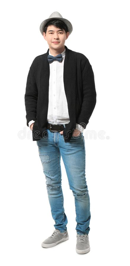 Ritratto dei pantaloni a vita bassa bei nel fondo alla moda di bianco dell'attrezzatura immagini stock