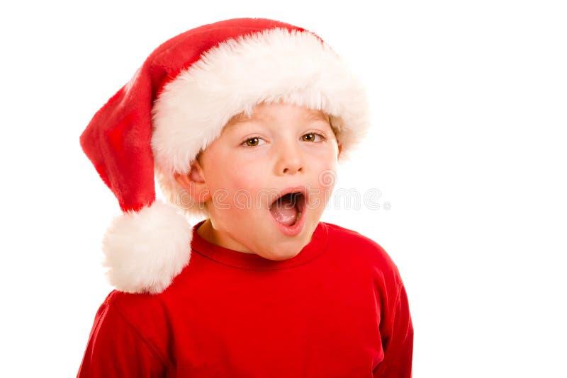 Ritratto del bambino che porta il cappello di Santa fotografia stock