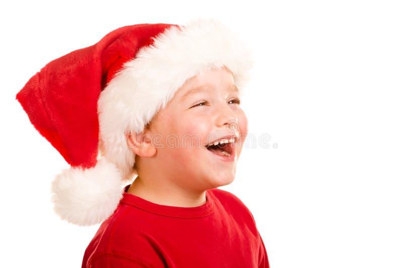 Ritratto del bambino che porta il cappello di Santa immagini stock