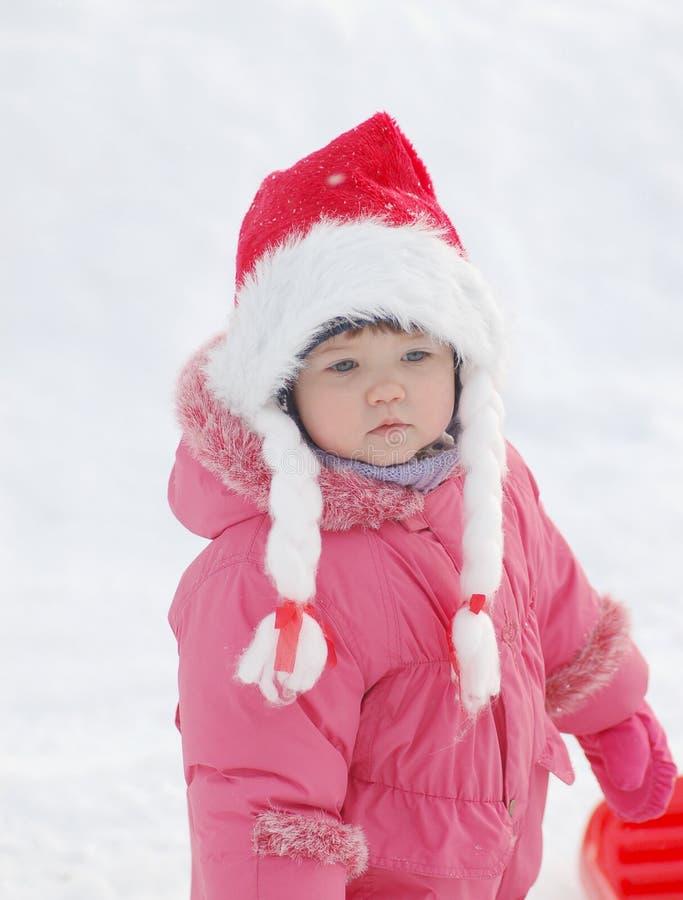 Ritratto del bambino nell'orario invernale fotografie stock libere da diritti