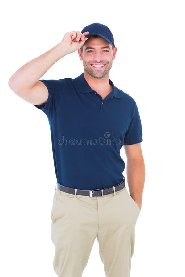Ritratto del cappuccio d'uso del fattorino felice fotografia stock
