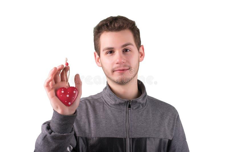 Ritratto del giovane con cuore decorativo su bianco immagini stock