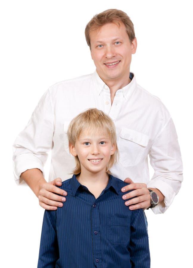 Ritratto del padre e del figlio nello studio immagini stock libere da diritti