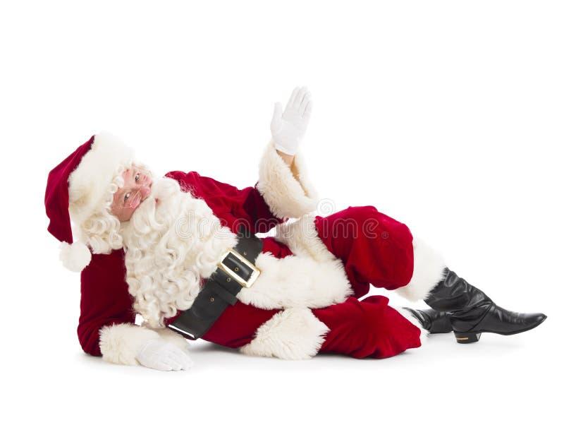 Ritratto del pavimento di Santa Claus Gesturing While Lying On fotografie stock