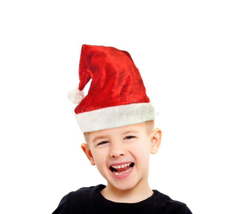 Ritratto del ragazzo di risata attraente in un cappuccio del ` s del nuovo anno fotografia stock