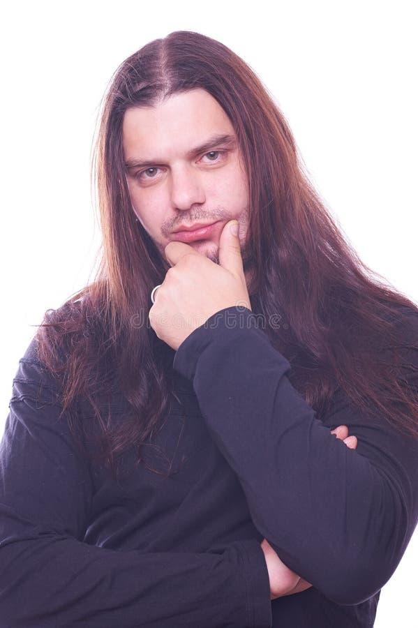 Ritratto del tizio con capelli scorrenti fotografie stock