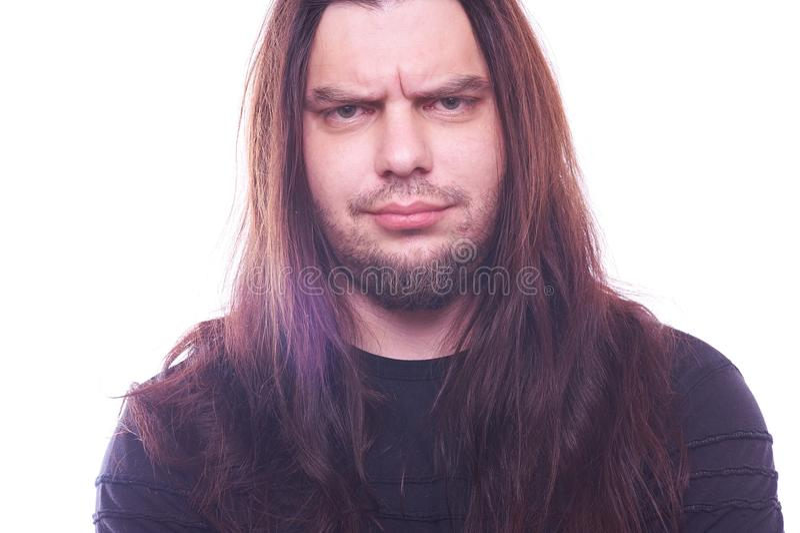 Ritratto del tizio con capelli scorrenti fotografie stock libere da diritti