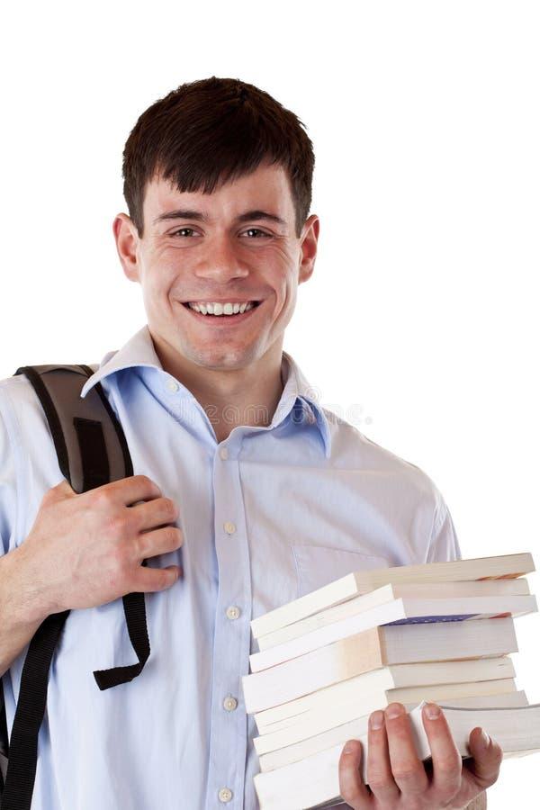 Ritratto dell'allievo maschio sorridente felice con i libri immagini stock libere da diritti