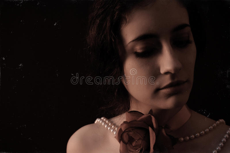 Ritratto dell'annata di una giovane donna fotografia stock libera da diritti