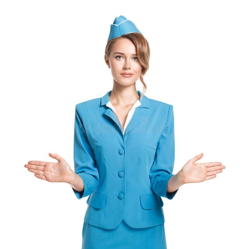 Ritratto dell'hostess affascinante che dura in uniforme del blu fotografia stock