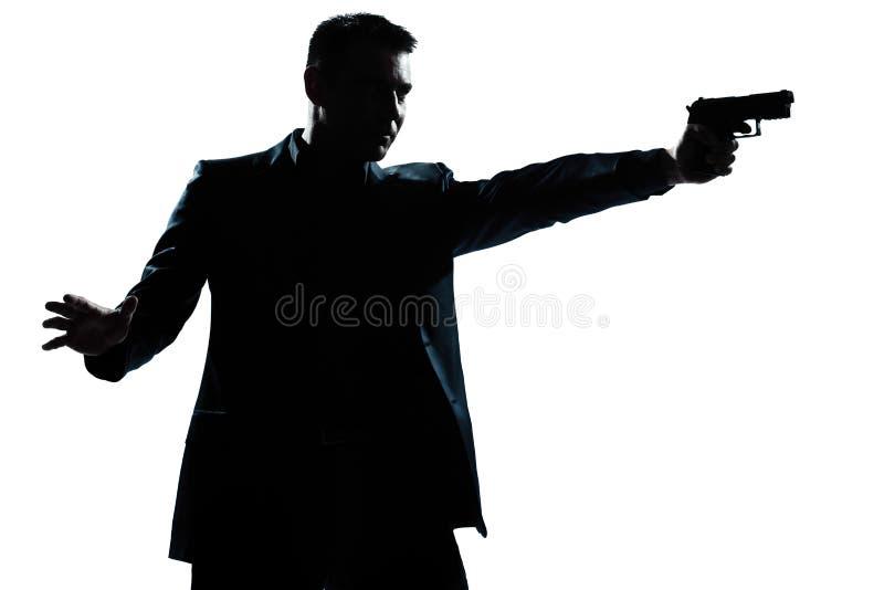 Ritratto dell'uomo della siluetta alla tendenza della pistola immagini stock libere da diritti