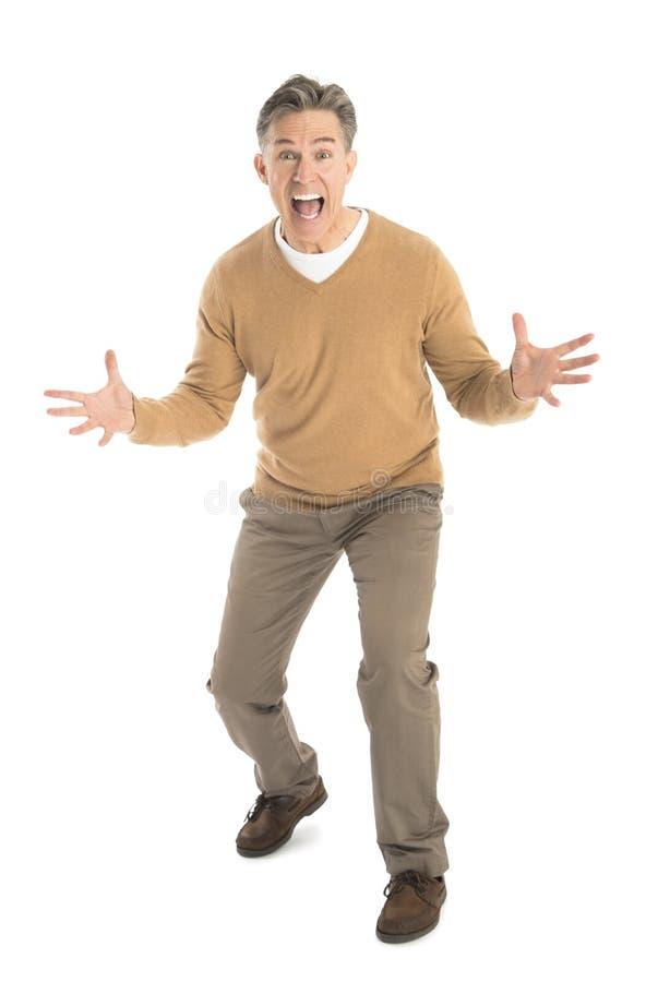 Ritratto dell'uomo frustrato che grida fotografia stock libera da diritti