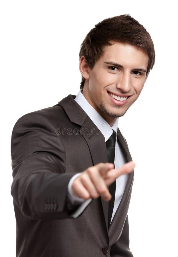 Ritratto dell'uomo sorridente che indica voi fotografia stock