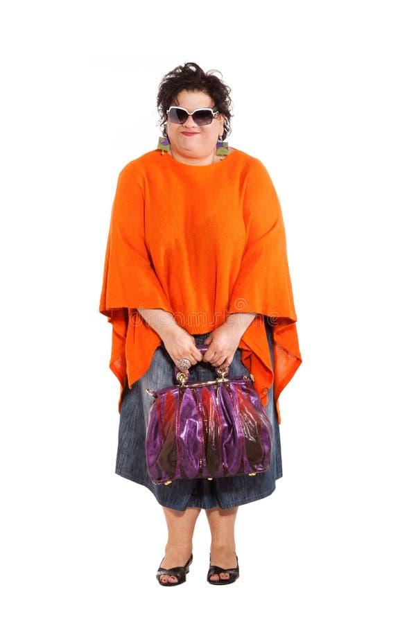 Ritratto della donna allegra con le sue borse fotografia stock
