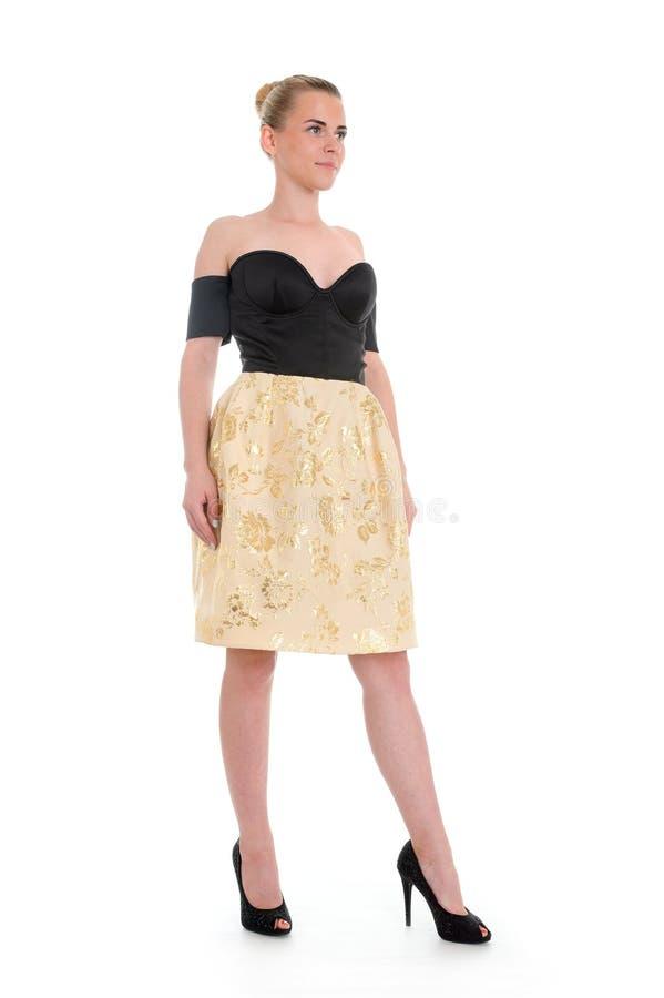 Ritratto della donna flirt in vestito dalla discoteca isolato fotografie stock libere da diritti
