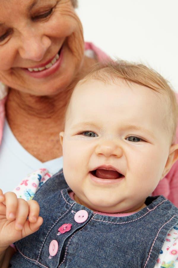 Ritratto della donna maggiore con il bambino immagini stock