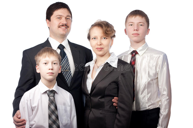 Ritratto della gente di famiglia di quattro in vestiti fotografia stock
