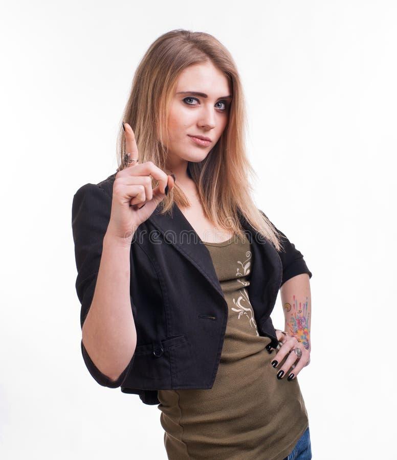 Ritratto della giovane donna attraente con il suo dito su immagini stock libere da diritti