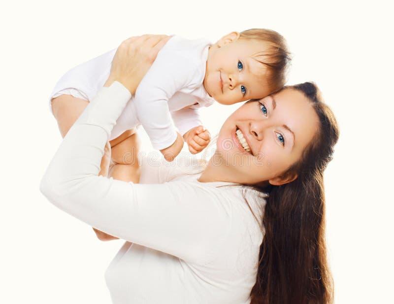 Ritratto della madre con il suo bambino sveglio immagine stock