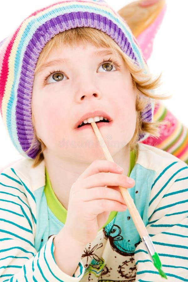 Ritratto della pittura del bambino in giovane età fotografia stock