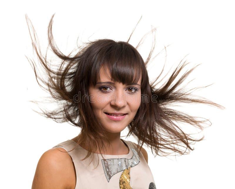 Ritratto della ragazza con capelli di salto lunghi isolati su fondo bianco fotografie stock