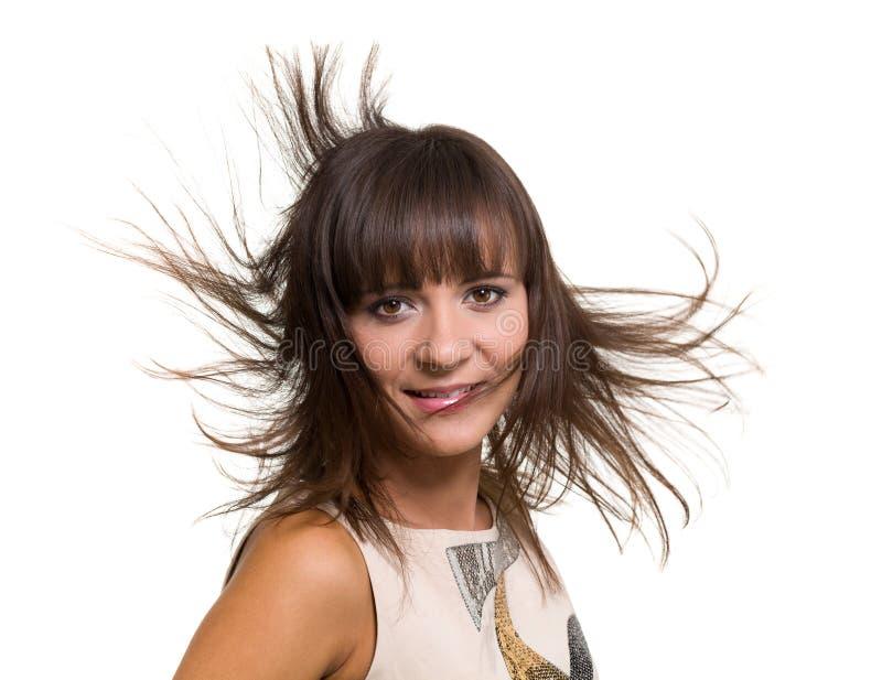 Ritratto della ragazza con capelli di salto lunghi isolati su fondo bianco immagini stock