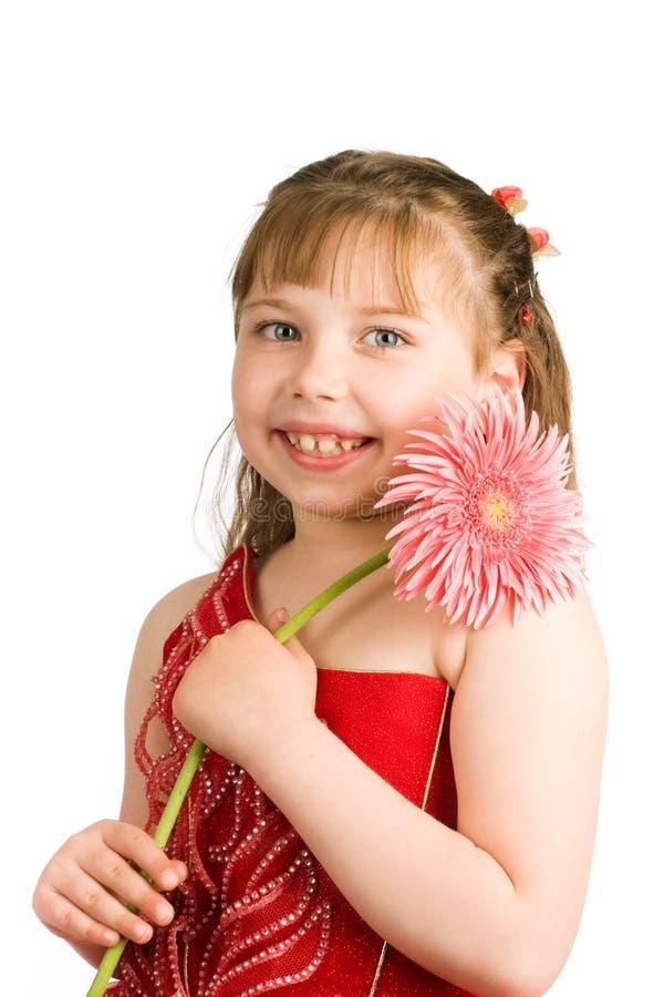 Ritratto della ragazza con il fiore fotografia stock